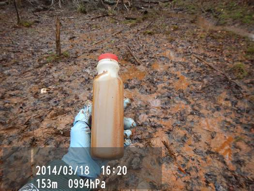 """Photo: Naujoks says this is a """"seep"""" from the Duke Buck Steam Plant coal-ash pond leaching onto state game lands, directly into the Yadkin River. Testing by the Yadkin Riverkeeper indicates chromium at 10-times the groundwater standard, and lead at six-times the standard. Courtesy: Yadkin Riverkeeper"""