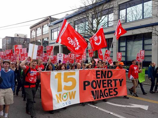 PHOTO: Marches, like this one in Seattle last month, have kept the pressure on the City of Seattle to adopt a $15 hourly minimum wage. The effort has stalled, at least temporarily, but it has gotten the attention of people across the nation. Photo courtesy 15Now.