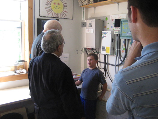 PHOTO: Fourth-grade students explain the solar installation that powers their classroom to Congressmen G.K. Butterfield and David Price. Photo courtesy Environment North Carolina