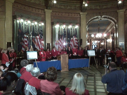 "PHOTO: Supporters of equal pay legislation will again gather in the Capitol rotunda today, many wearing red to symbolize that women's paychecks are ""in the red"" compared to those of their male counterparts. Photo courtesy of M.Pollock/Michigan NOW."