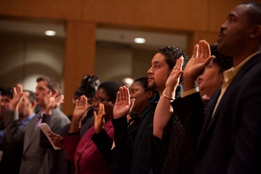 PHOTO: New U.S. Citizens take the oath of allegiance during a naturalization ceremony. Photo courtesy of The White House
