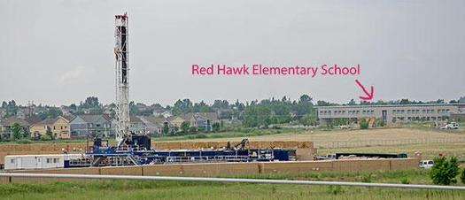 PHOTO: This photo, seen in the petition filed by Earthjustice on Tuesday, shows a Colorado school near oil and gas well sites. The petition asks for new air quality rules for drilling and fracking. Photo courtesy Lighthouse Solar.