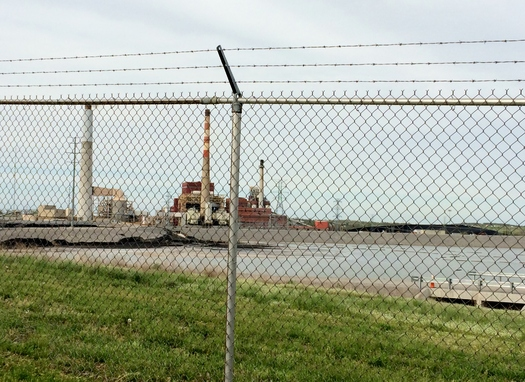PHOTO: A Sierra Club report alleges this coal ash pond at the E.W. Brown Generating Station is contaminating surface and groundwater. Photo courtesy Alex DeSha, Sierra Club.