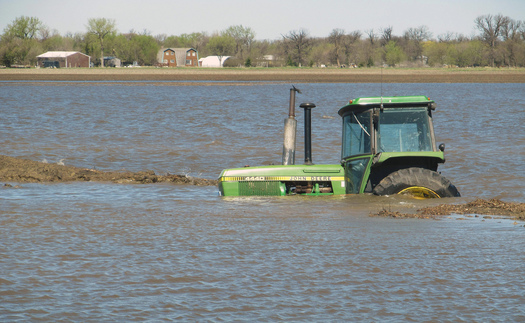 PHOTO: More frequent severe weather extremes are a concern for rural residents across the Midwest, as witnessed by this abandoned tractor during flooding last year in North Dakota. Photo courtesy U.S. Department of Agriculture.