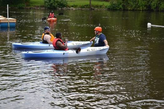 PHOTO: Trip organizer Scott Fraser, right, uses kayaking to help veterans and others living with disabilities or cognitive challenges regain independence and enhance their lives. Photo credit: Highland River Adventures, Vineyard Production.