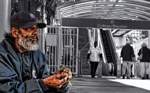 PHOTO: A homeless man seeks shelter in downtown Miami, where the City Commission has delayed a decision on whether to outlaw camping on public property for another month. Photo credit: xynntii/Flickr.com.