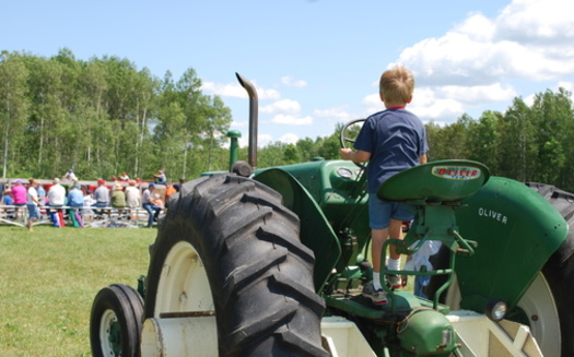 County fairs in Iowa attract 3.5 million visitors, who support young people in agriculture along with enjoying the rides, food and fun. (Cheryl Peters/Morguefile)