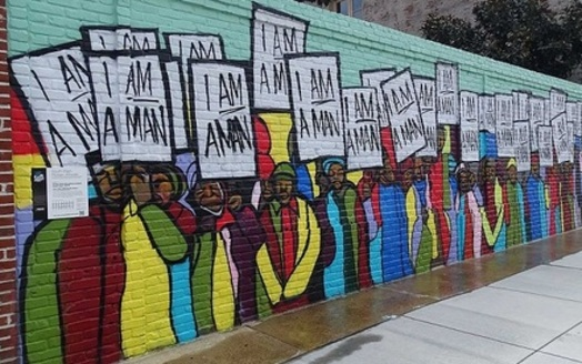 A mural in Memphis depicts the sanitation workers' strike 50 years ago. (Xzelenz/Wikimedia)