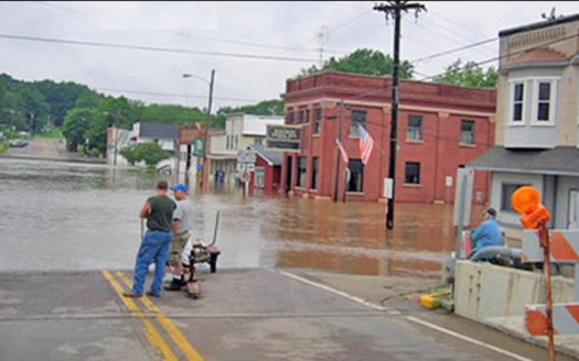Spring flooding in Wisconsin can be devastating, as in Rock Springs in 2016, when the Baraboo River overflowed. Democrats say a bill under consideration would make flooding worse. (NOAA)