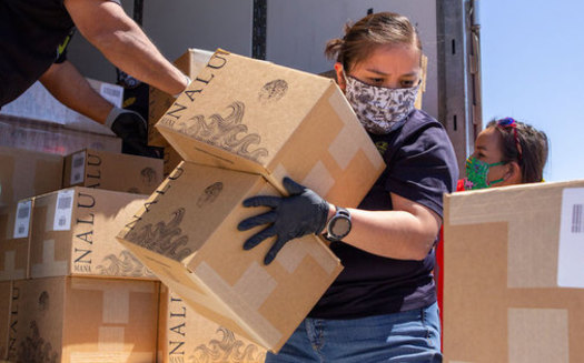 Volunteers unload boxes of water on the Navajo Nation as part of a grassroots food-distribution effort to help the 180,000 tribal members during the coronavirus pandemic. (Deidra Peaches)