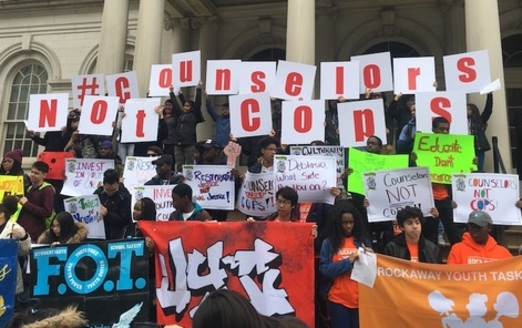 Students rallying at City Hall in New York City call for more guidance counselors and fewer police in public schools. (Photo: Urban Youth Collaborative)