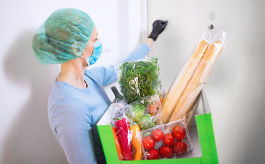 Food banks are critical community resources for families dealing with job losses during the pandemic. (astrosystem/Adobe Stock)