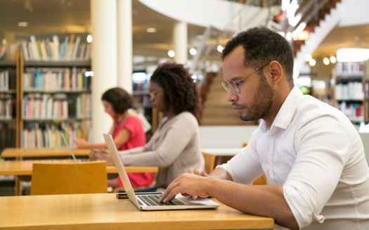 Almost two-thirds of Americans say closing their local library would have a major impact on their community, according to a 2015 Pew survey. (Adobe Stock)