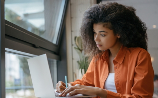 A new survey shows Black and Latino students in Virginia are twice as likely as white students not to have a computer in the home. (Adobe stock)