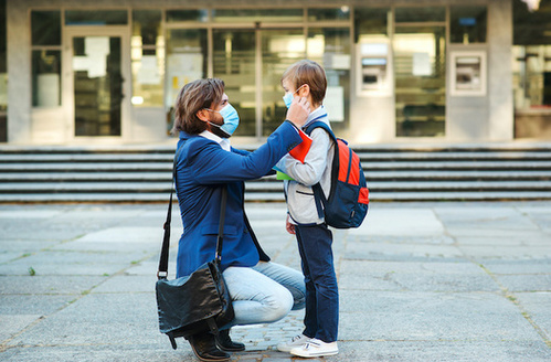 Many parents are juggling teaching their kids from home and working at the same time. (Adobe Stock)