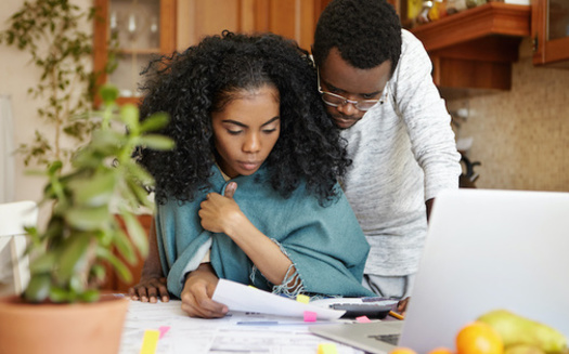 Census Household Survey data from this fall shows many Illinois families are behind on bill payments and struggling to keep food on the table. (Adobe Stock)