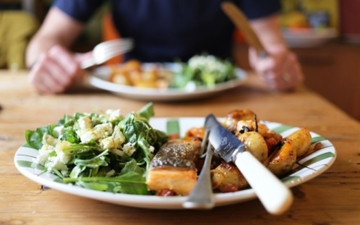 Dieticians say preparing meals at home makes it easier to keep track of added sugars, fats and sodium in your diet. (Adobe Stock)