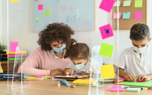 During the pandemic, a handful of South Dakota school districts have given bonuses to teachers, but advocates say the state needs to live up to its promise to gradually boost educators' salaries each year. (Adobe Stock)