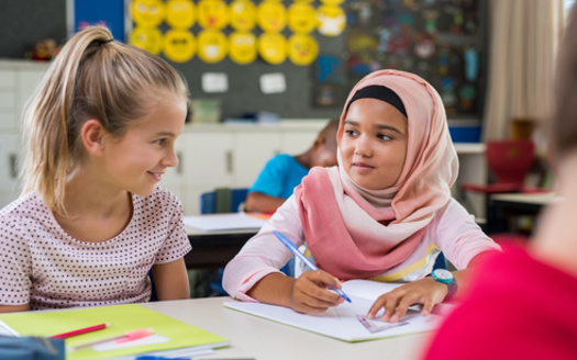 A total of five public school districts in Iowa, including Davenport, Des Moines and Waterloo, have adopted diversity plans to shield against too many students leaving for other districts. (Adobe Stock)