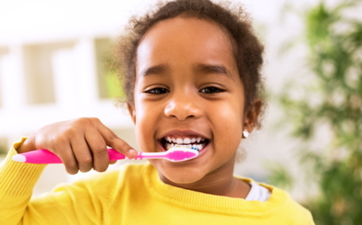 During Children's Dental Health Month, dentists recommend families maintain good oral health routines, even if the pandemic is delaying trips to the dentist. (Adobe Stock)