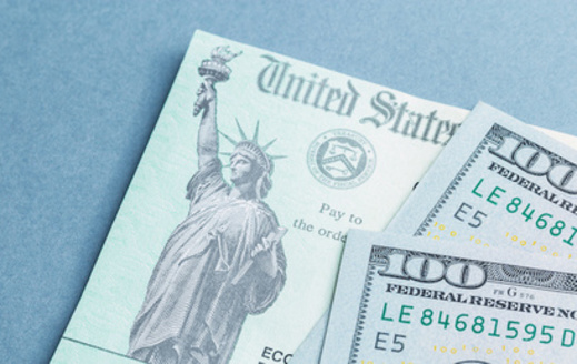 More than 2.1 million Oregonians received stimulus checks during the first round of relief last year. (Jeff McCollough/Adobe Stock)