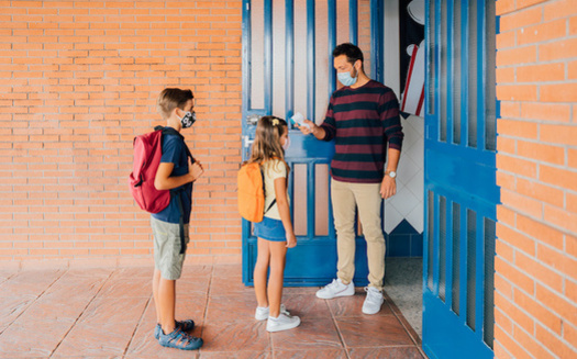 Schools need to take multiple precautions to keep students, staff and families safe from COVID-19 as classrooms reopen. (ManuPadilla/Adobe Stock)