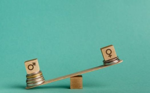 Iowa consistently ranks low among all states for its gender pay gap, and almost 34% of female-headed households in the state live in poverty. (Adobe Stock)