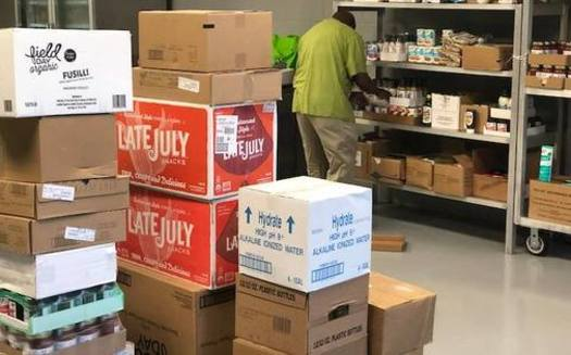 Volunteers stock shelves at SHARE Cooperative in Winston-Salem. (Facebook)<br />