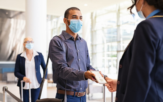 The CDC says fully vaccinated people can interact with others who are fully vaccinated without masks or distancing, but precautions are still necessary in certain instances, especially travel. (Rido/Adobe Stock)
