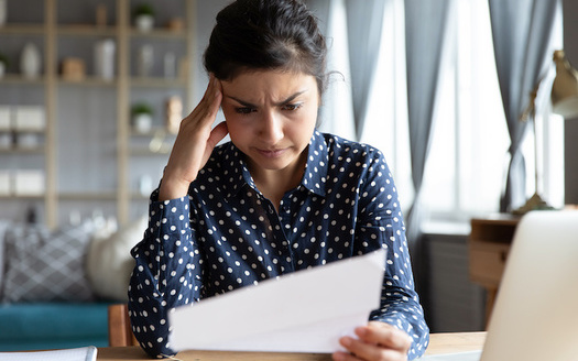 People who have medical debt or trouble paying medical bills are more likely to have continued health issues, from high blood pressure and mental health concerns to a shorter life expectancy.(Adobe Stock)