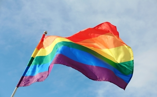 Advocates say a video which went viral of a boy cutting down a Pride flag in front of his school sends a negative message to Utah's transgender and LGBTQ students. (Adobe Stock)