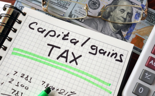 In a new poll, 64% of New Hampshire voters said they think capital gains should be taxed at the same rate as income from wages; 56% support increasing the corporate tax rate to 28%. (Vitalii Vodolazskyi/Adobe Stock)
