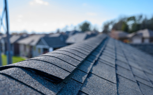 In addition to roof repairs and other home improvements to lower utility bills, a Michigan League for Public Policy report recommends expanding utility-shutoff protections to include households with young children. (Adobe Stock)