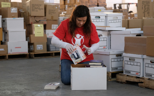 Save the Children worker Alissa Taylor packs school supplies for needy families in rural Kentucky. (Shawn Millsaps/Save The Children)