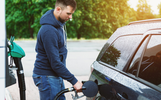 When drivers fill up their tanks in Massachusetts, they pay 24 cents per gallon to the state and a little more than 18 cents per gallon to the federal government. (blackday/Adobe Stock)