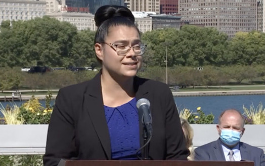 Dulce Ortiz of Clean Power Lake County was among those who spoke at the signing of landmark clean-energy legislation in Illinois. (Office of Gov. J.B. Pritzker)