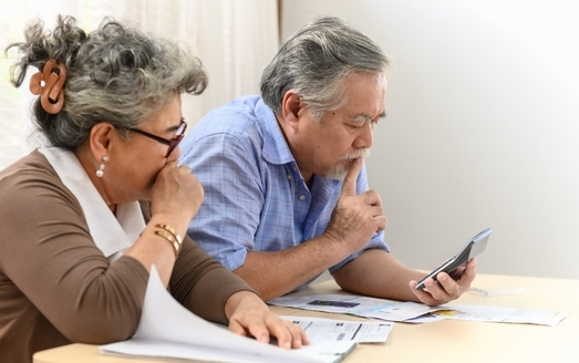 An AARP study shows the high cost of prescription drugs often forces American seniors to choose between paying for their prescriptions or buying food or paying bills. (pitipat/Adobe Stock)
