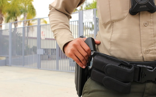 More than a dozen school districts across California have begun to reassess their school resource officer programs, in an effort to limit the number of students entering the justice system. (Simone/Adobestock).