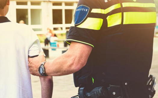 Public schools need to minimize arrests at schools by using emergency mental-health teams instead of police officers to address behavioral incidents at school, according to a Sentencing Project report. (Adobe stock)