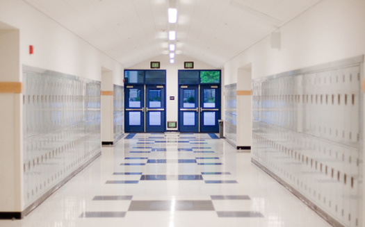 New Hampshire's Lebanon School District, facing pressure to do away with its school resource officer position, has decided to keep it for now while an outside firm studies equity and race issues in the city's schools. (Michael Ireland/Adobe Stock)