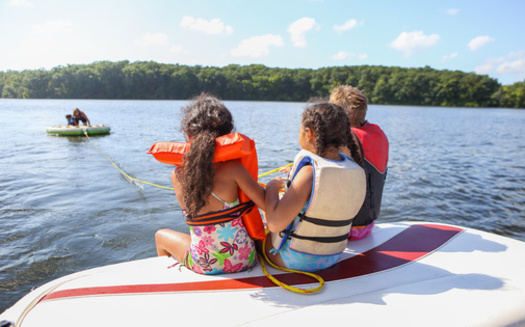 In addition to protecting shorelines, Minnesota lake advocates say enhanced boater training could protect all lake users from powerful waves that come from bigger watercraft. (Adobe Stock)