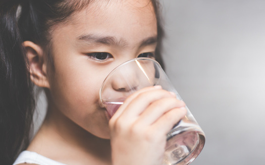 A 2020 report by the Environmental Working Group identified the presence of PFAS chemicals in the tap water of dozens of U.S. cities where contamination was not previously suspected. (Adobe Stock)<br />
