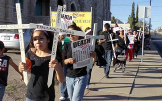 PHOTO: Día de los Muertos march in El Paso honoring Mexicans who died trying to emigrate (November, 2011). Credit: Cristina Parker.