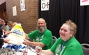 PHOTO: Randy Kurtz and Karen Mork, members of the Washington Federation of State Employees, help with registration at the Washington State Labor Council convention. Donations are also being collected for wildfire relief efforts in the area. Photo credit: Tim Welch