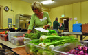 PHOTO: A volunteer prepares food at the Women and Children�s Free Restaurant in Spokane. The food-assistance program helps clients supplement SNAP benefits that don't always cover food needs. Photo courtesy Northwest Harvest.