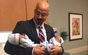 PHOTO: Dr. Corey Iqbal holds 1-month-old twins Kerlin and Orlando Morales-Botello, the first patients at Children's Mercy Hospital in Kansas City, Mo., to undergo a state-of-the-art procedure to treat a potentially fatal complication while in-utero. Photo courtesy of J. Salazar.