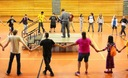 PHOTO: Program director Nation Wright leads a traditional Native American round dance with students at Minnesota's American Indian Freedom Schools program, the first of its kind among the more than 200 Freedom Schools sites across the United States. Photo courtesy of CDF-Minnesota.