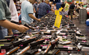 An executive action would expand mandatory background checks for firearm sales at gun shows. (M and R Glasgow/Flickr)