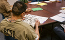 Pop Culture Classroom kicks off a new literacy program at the Sterling Correctional Facility on Saturday. (Stephanie Wolf/Colorado Public Radio)