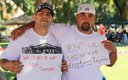 PHOTO: Two men hold signs describing how treatment and recovery has changed their lives. A new state audit says only about half of those released from prison who need substance abuse treatment are getting it. Courtesy PSJ.